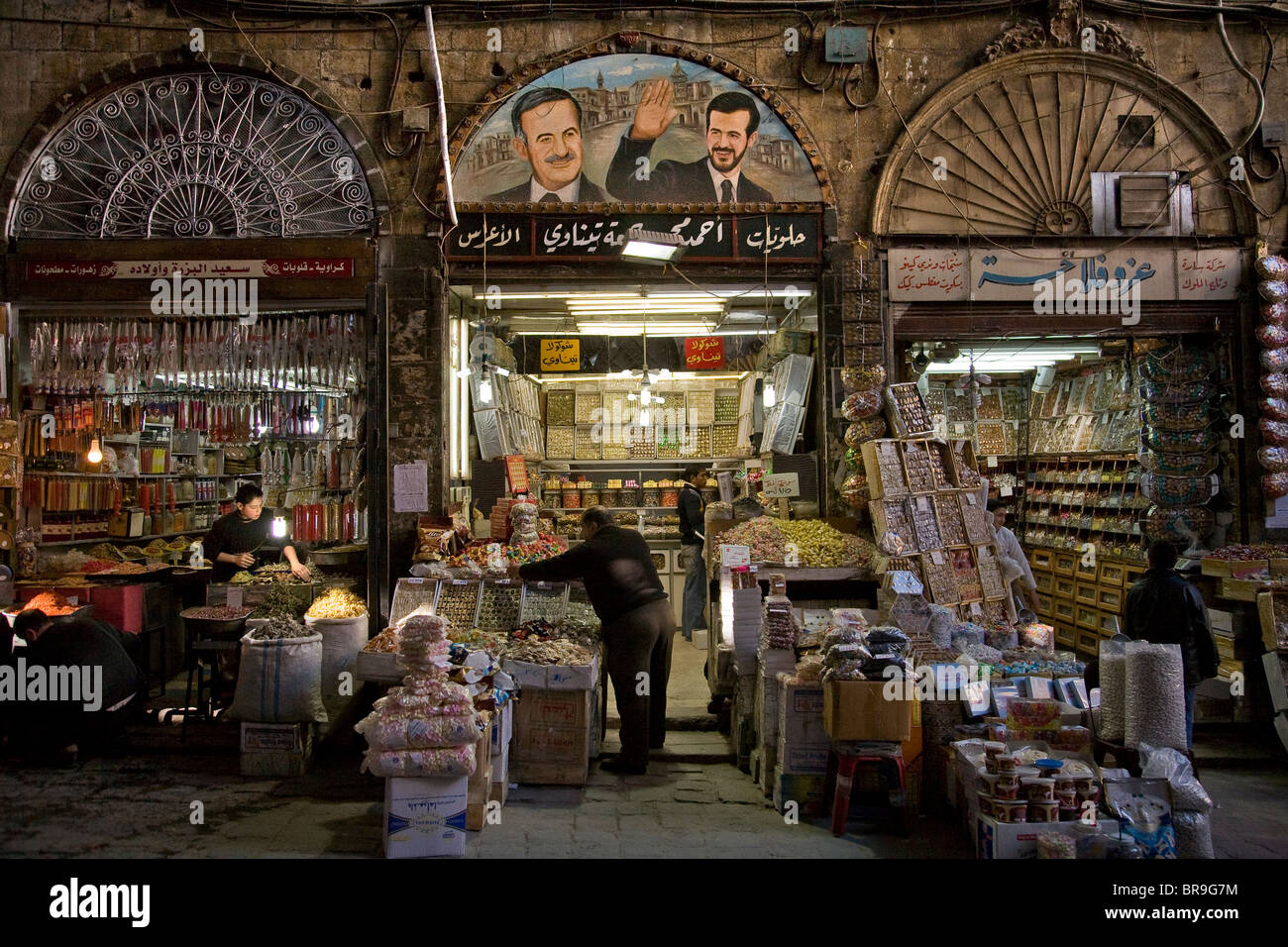 Painting of Basil and Hafez al-Assad in the Souk in Damascus Syria. - Stock Image