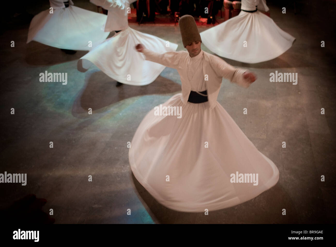 Whirling Dervishes perform traditional dance Istanbul Turkey. - Stock Image