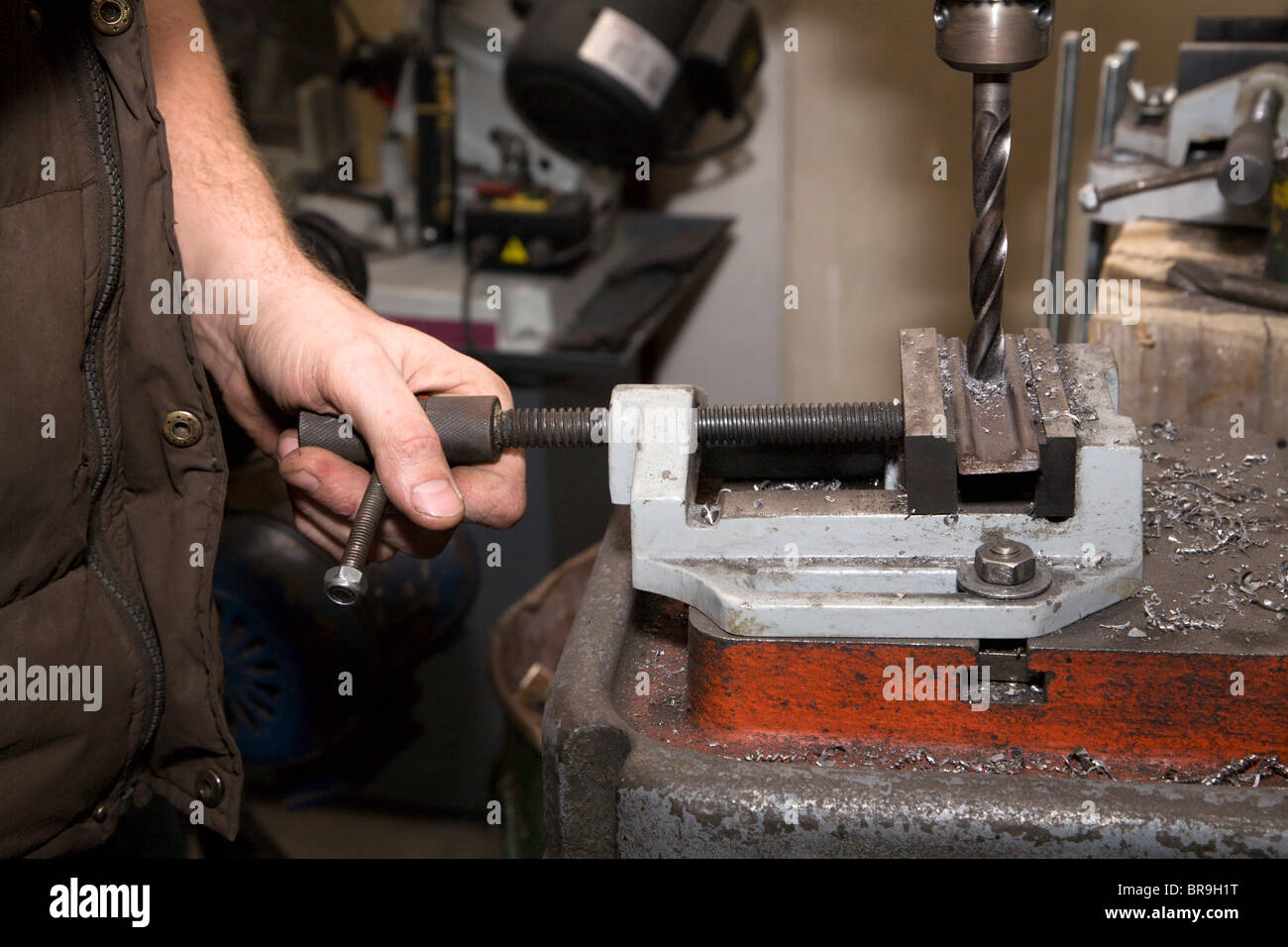 hands by the work on the drill - Stock Image