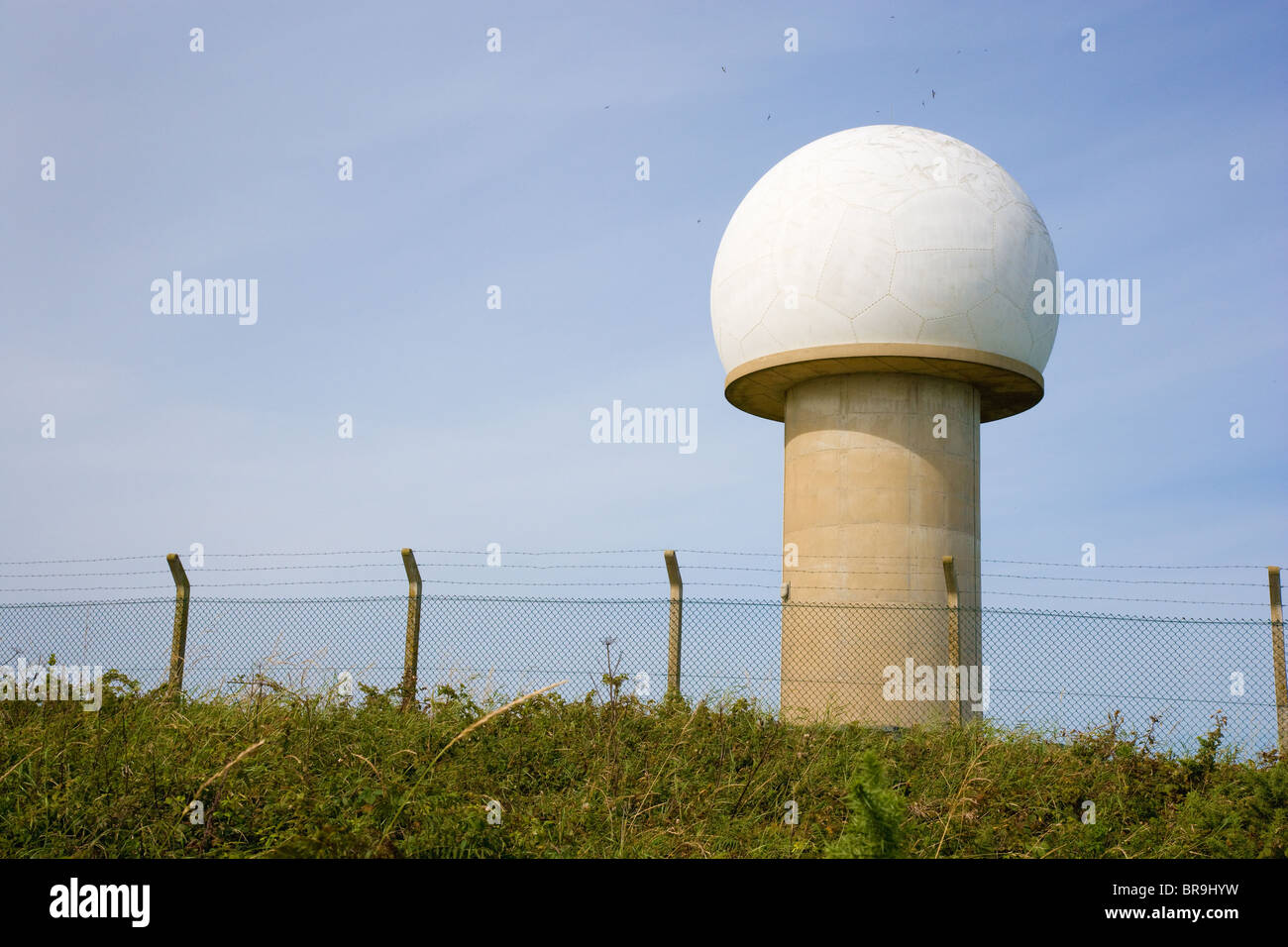 Dome and tower of radar station overlooking Barley Bay near Hartland Point on the coast of North Devon - Stock Image