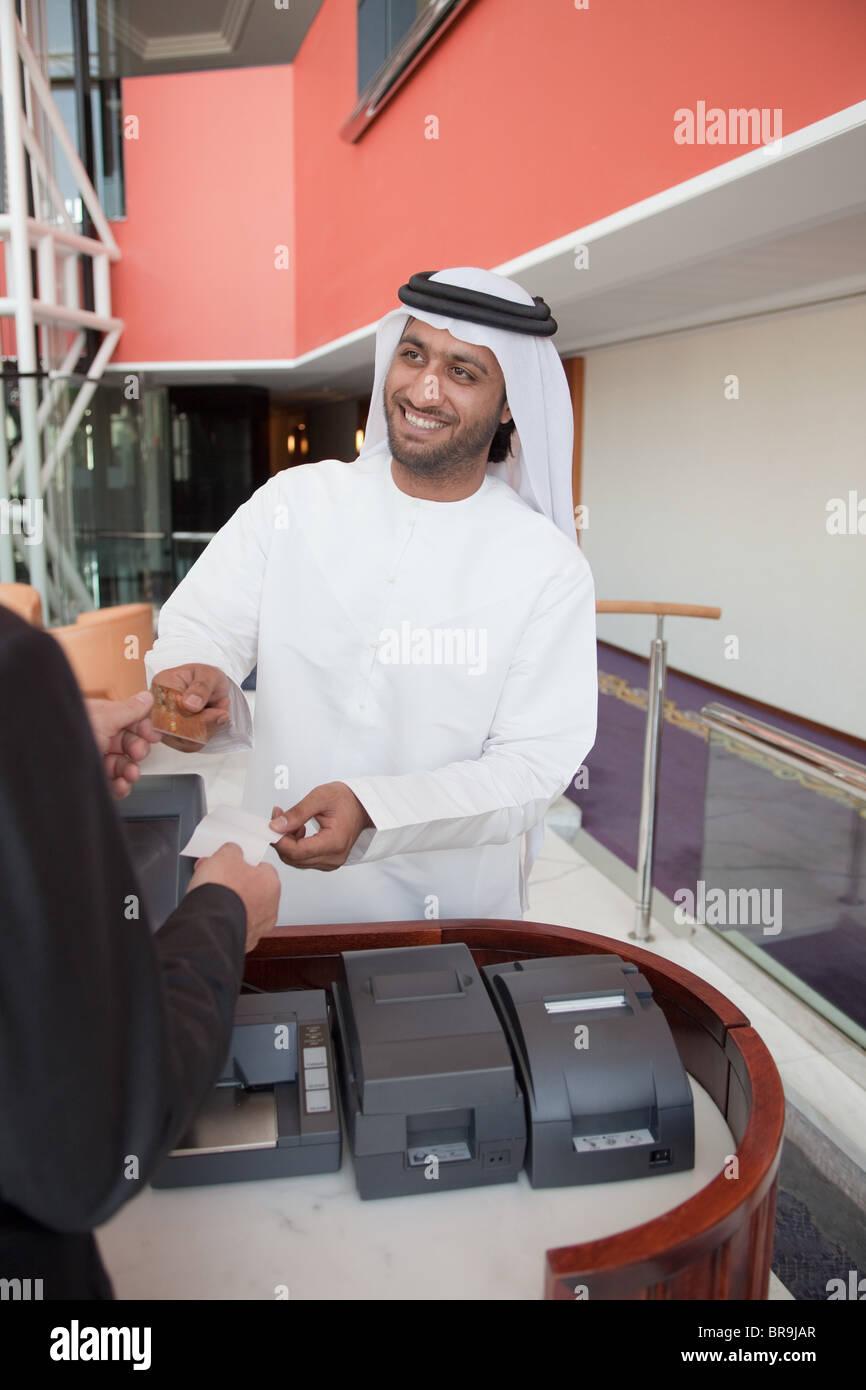 Middle eastern businessman making transaction - Stock Image