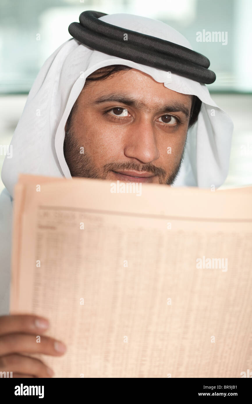 Middle eastern businessman with financial newspaper - Stock Image