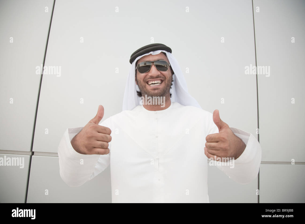 Middle eastern man giving thumbs up sign - Stock Image