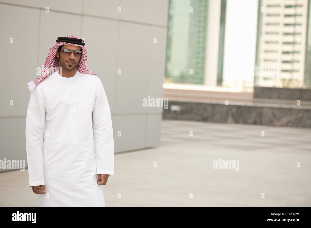 Middle eastern man in city - Stock Image
