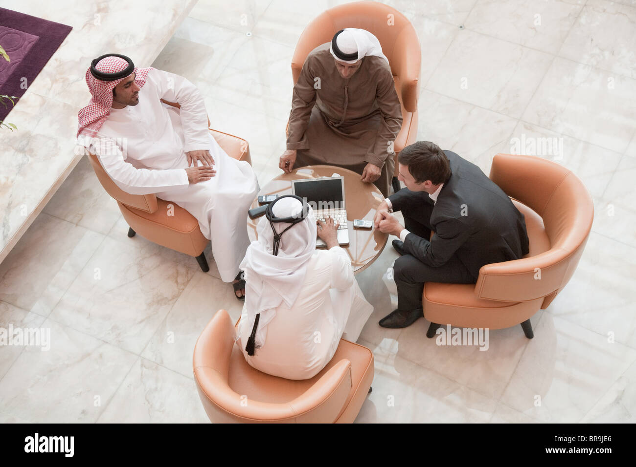High angle view of businessmen having a meeting - Stock Image