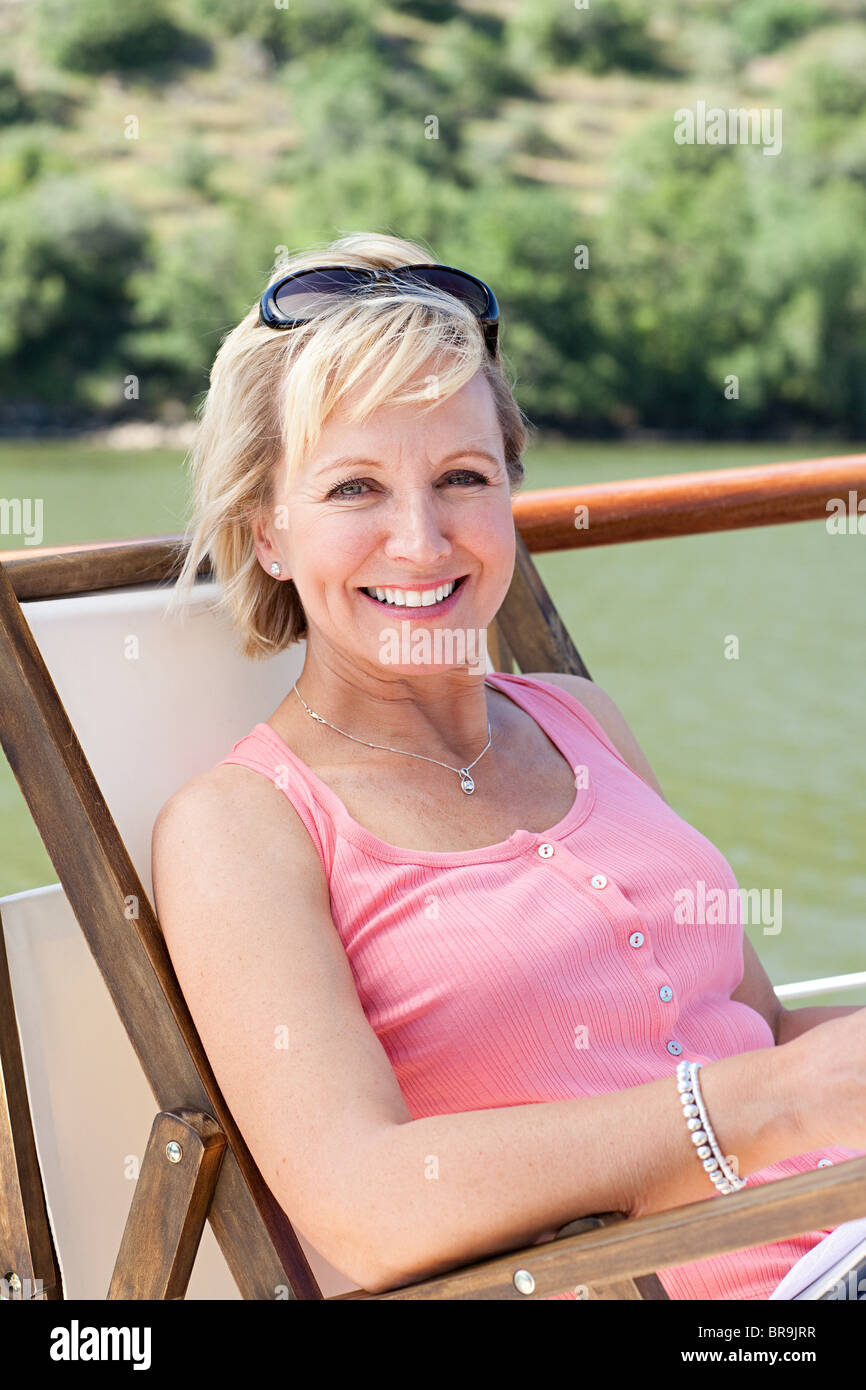 Mature woman on a boat holiday - Stock Image