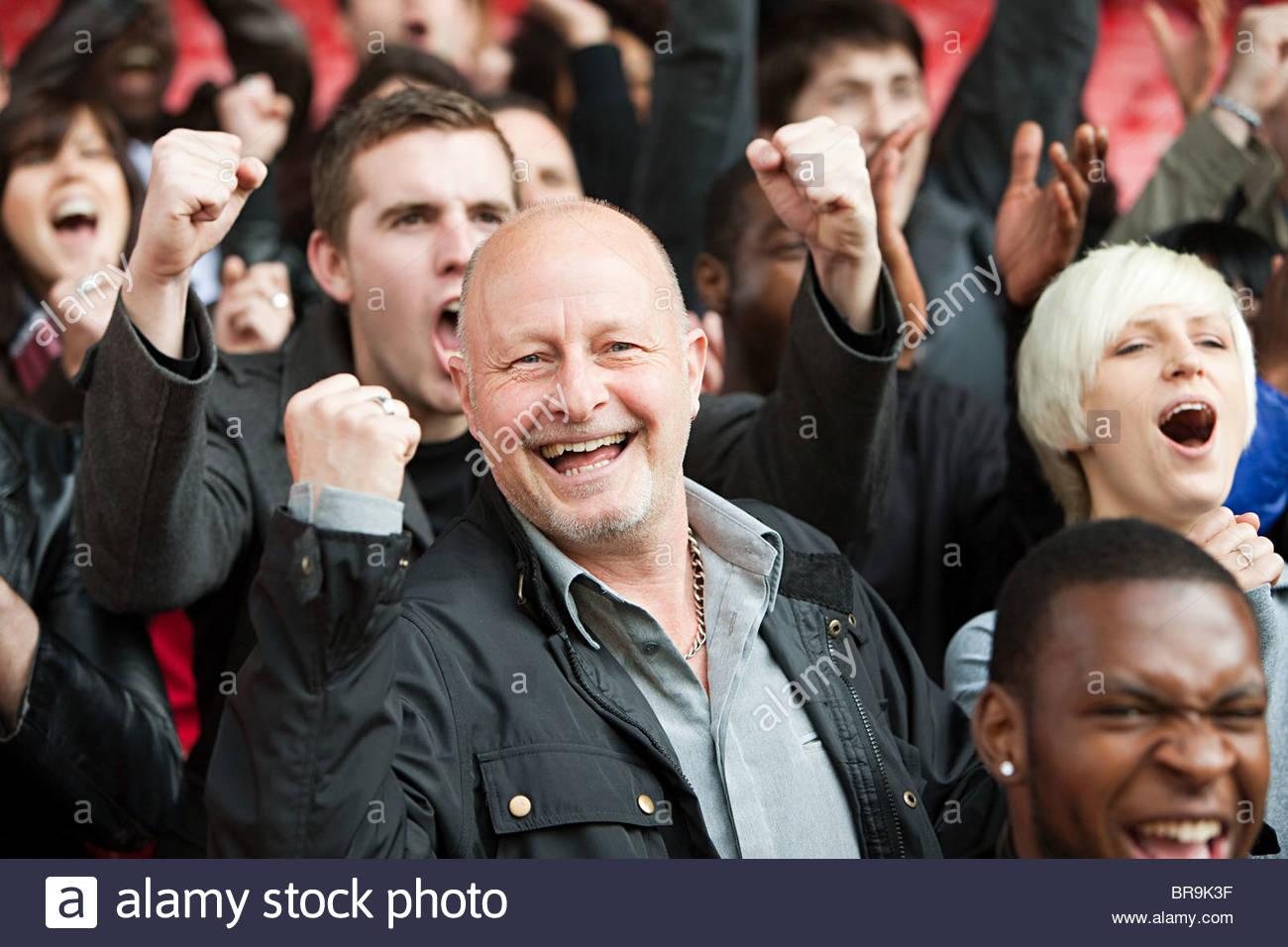 Happy man at football match - Stock Image