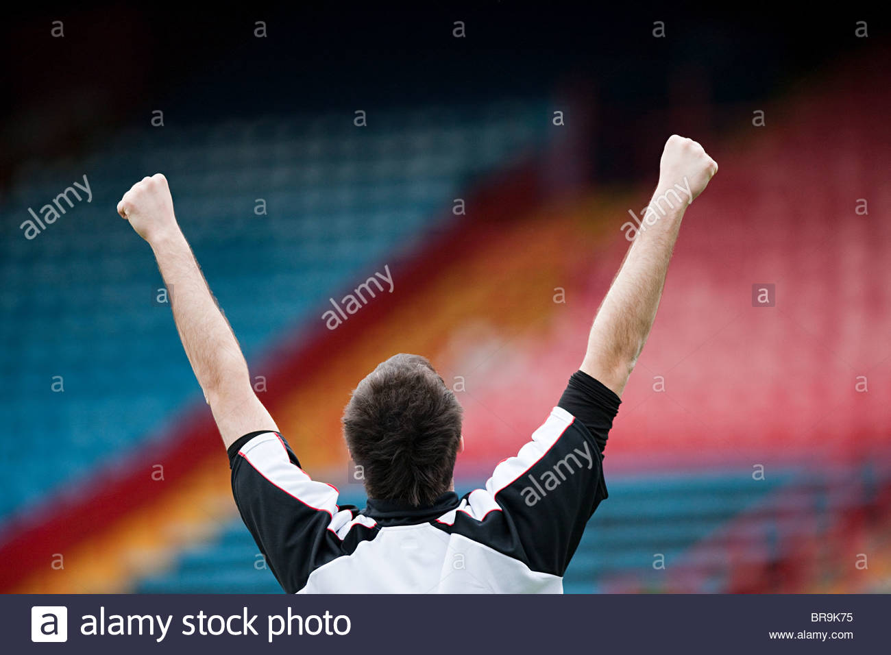 Footballer punching the air - Stock Image