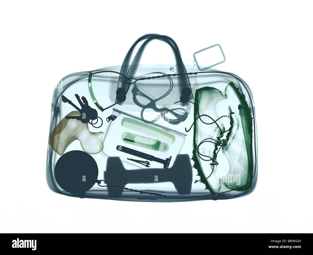 Xray image of bag containing sports equipment - Stock Image
