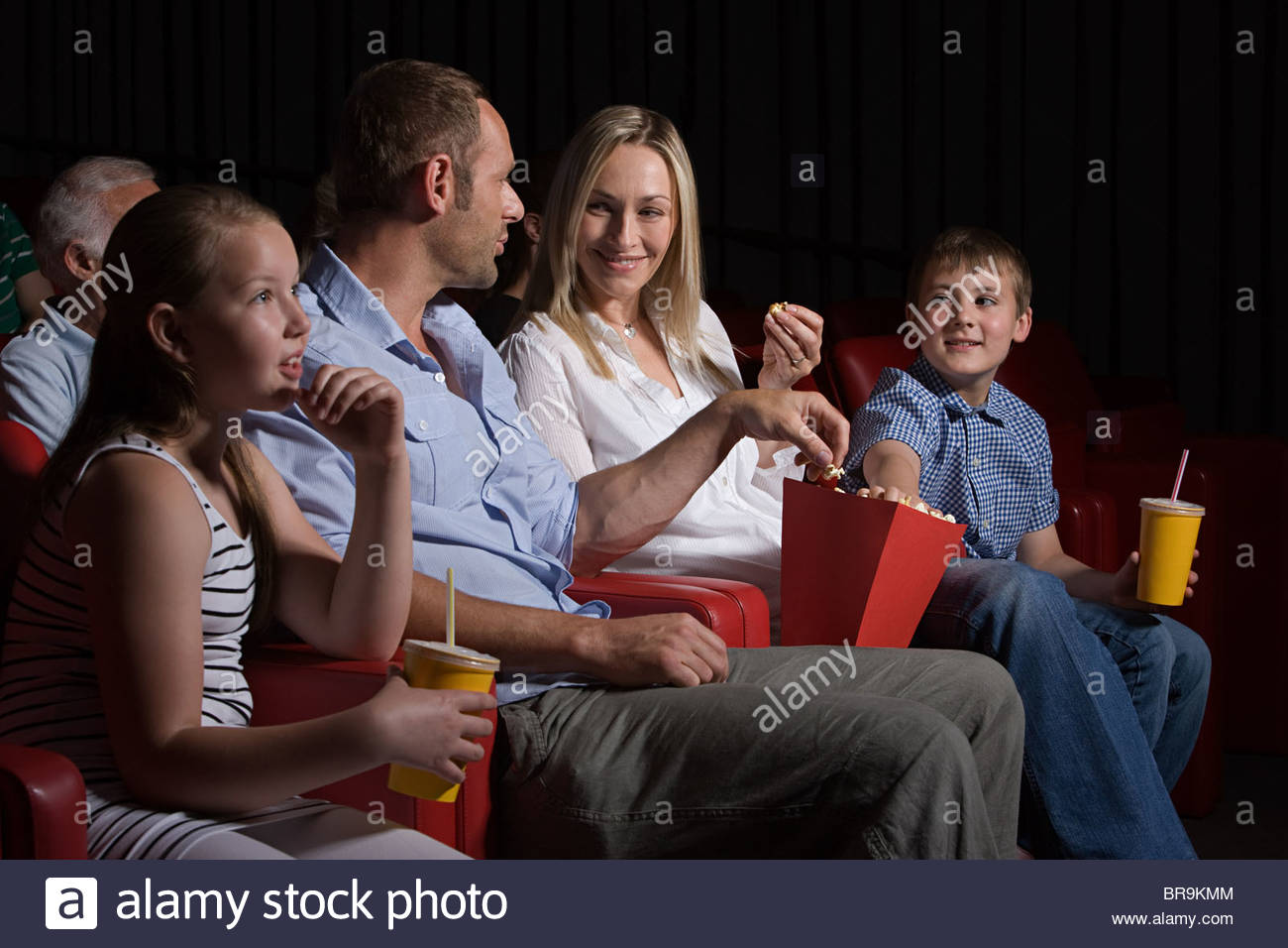 family watching movie at the movie theater stock photo 31560500 alamy