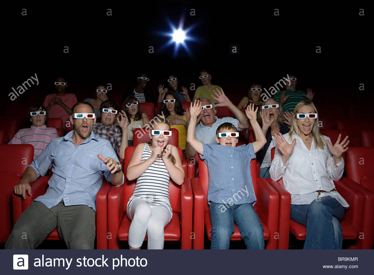 Family watching 3d movie at the movie theater - Stock Image