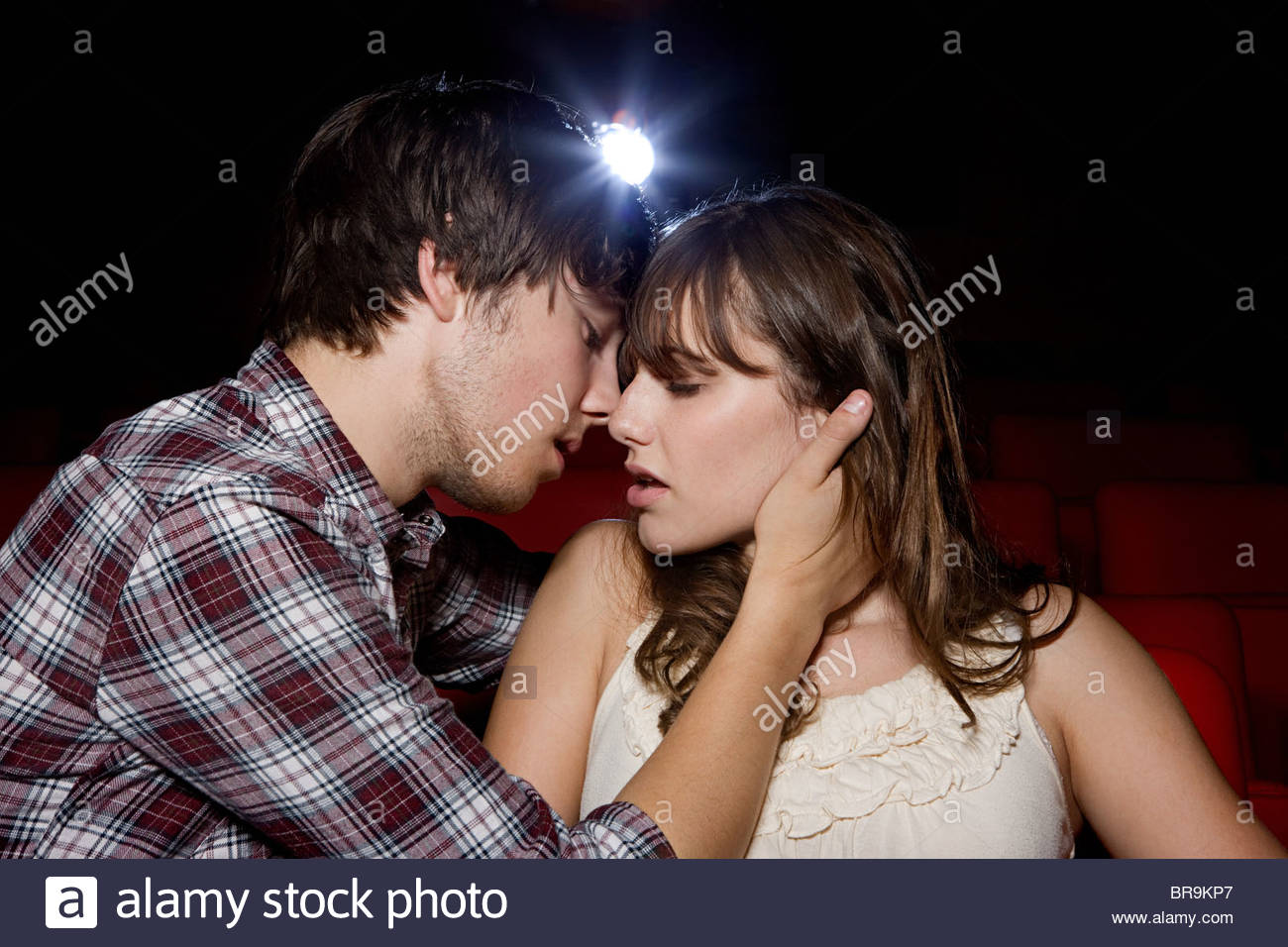 passionate young couple in the movie theater stock photo 31560543