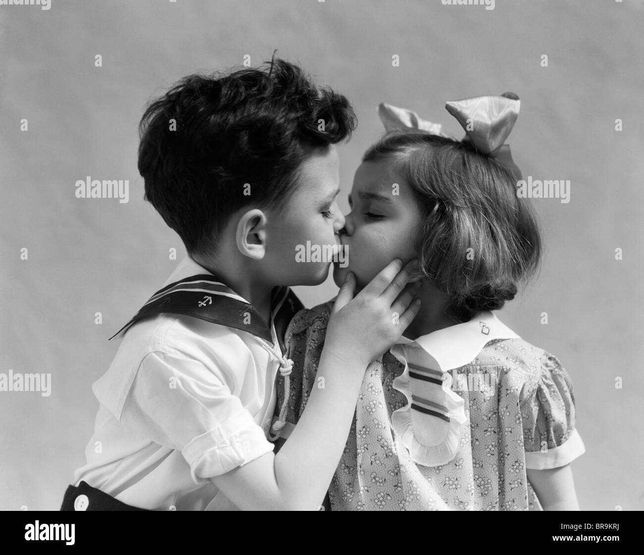 1930s Two Children Young Boy And Girl Kissing Stock Photo 31560582