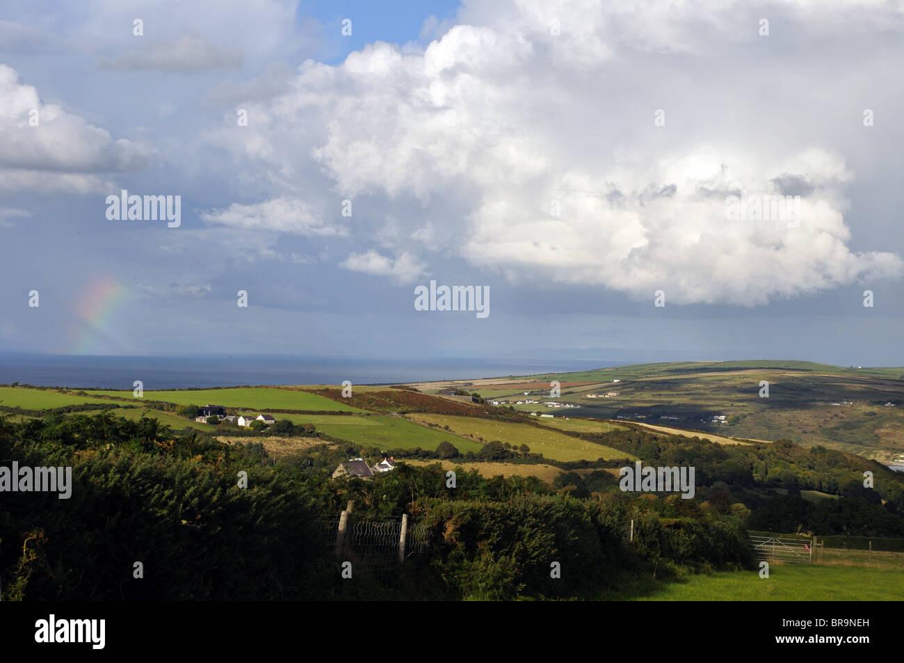 Cumulonimbus cloud and rainbow, Cardigan Bay, St Dogmaels, River Teifi, Pembrokeshire, Wales, United Kingdom - Stock Image