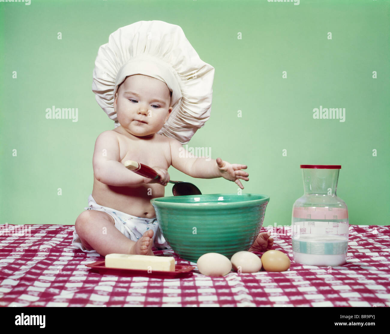 cb3744109ac 1960s BABY WEARING CHEF HAT SPOON MIXING BOWL AND BAKING INGREDIENTS ...