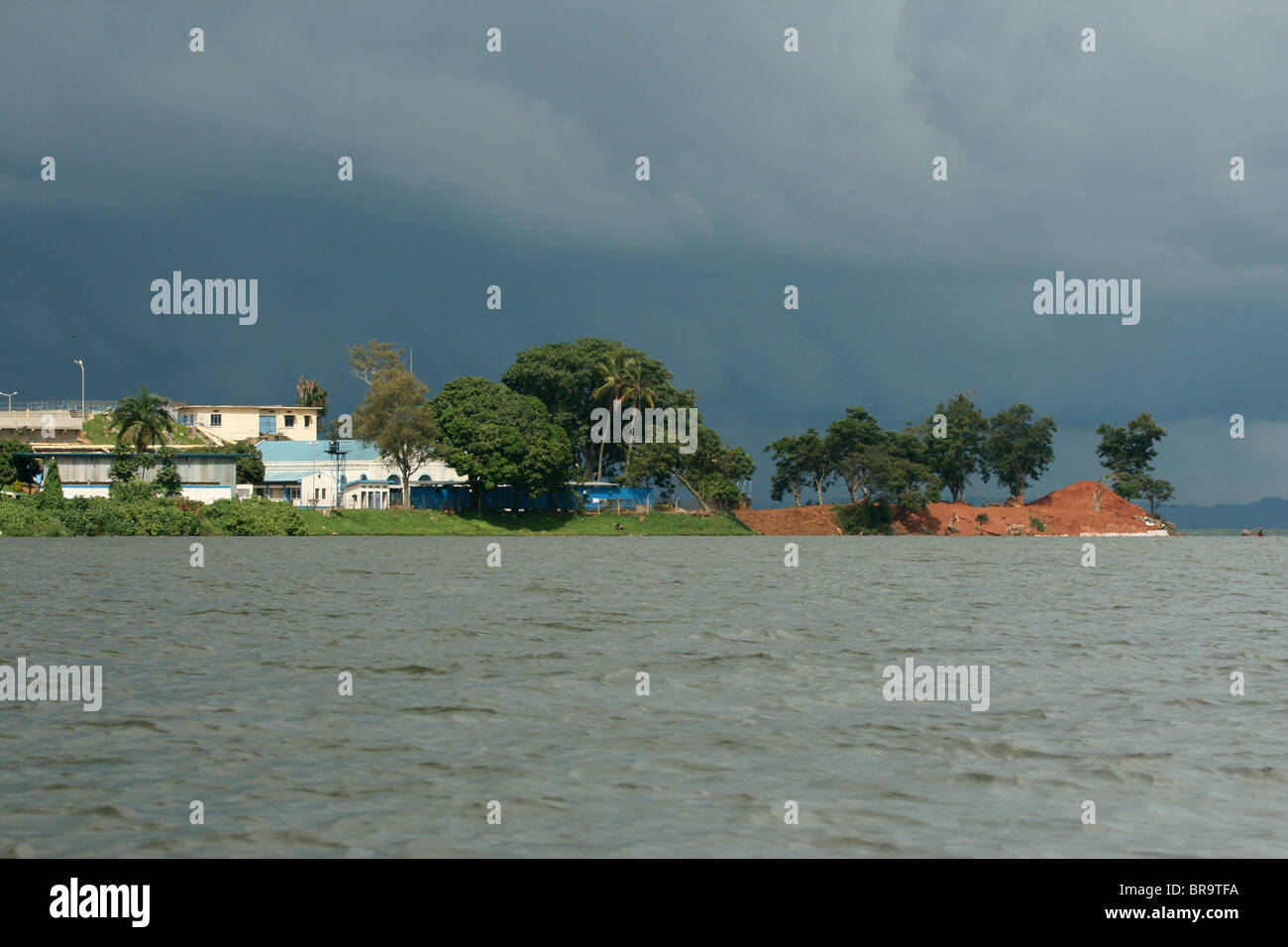 View of the Ggaba water works on Lake Victoria that supply Kampala with drinking water, image captured with a rain - Stock Image