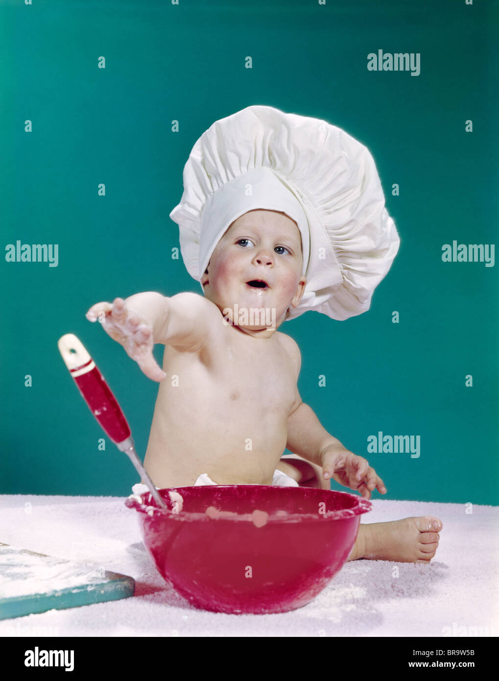 96ff3de79ac 1960s BABY WEARING CHEF HAT WITH RED MIXING BOWL AND SPOON FUNNY FACIAL  EXPRESSION