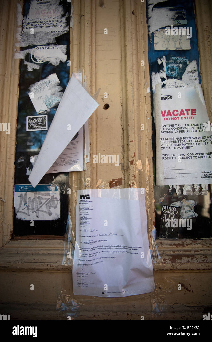 Front door of a building in Williamsburg Brooklyn, New York with vacate orders - Stock Image