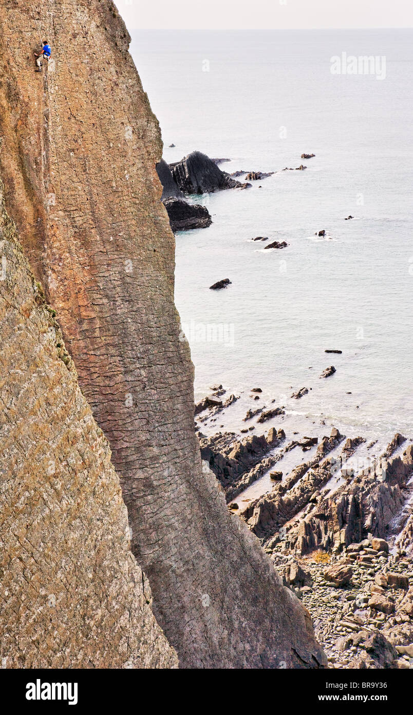 Solitary climber on Dyer's Lookout near Hartland Quay on the north Devon coast - Stock Image