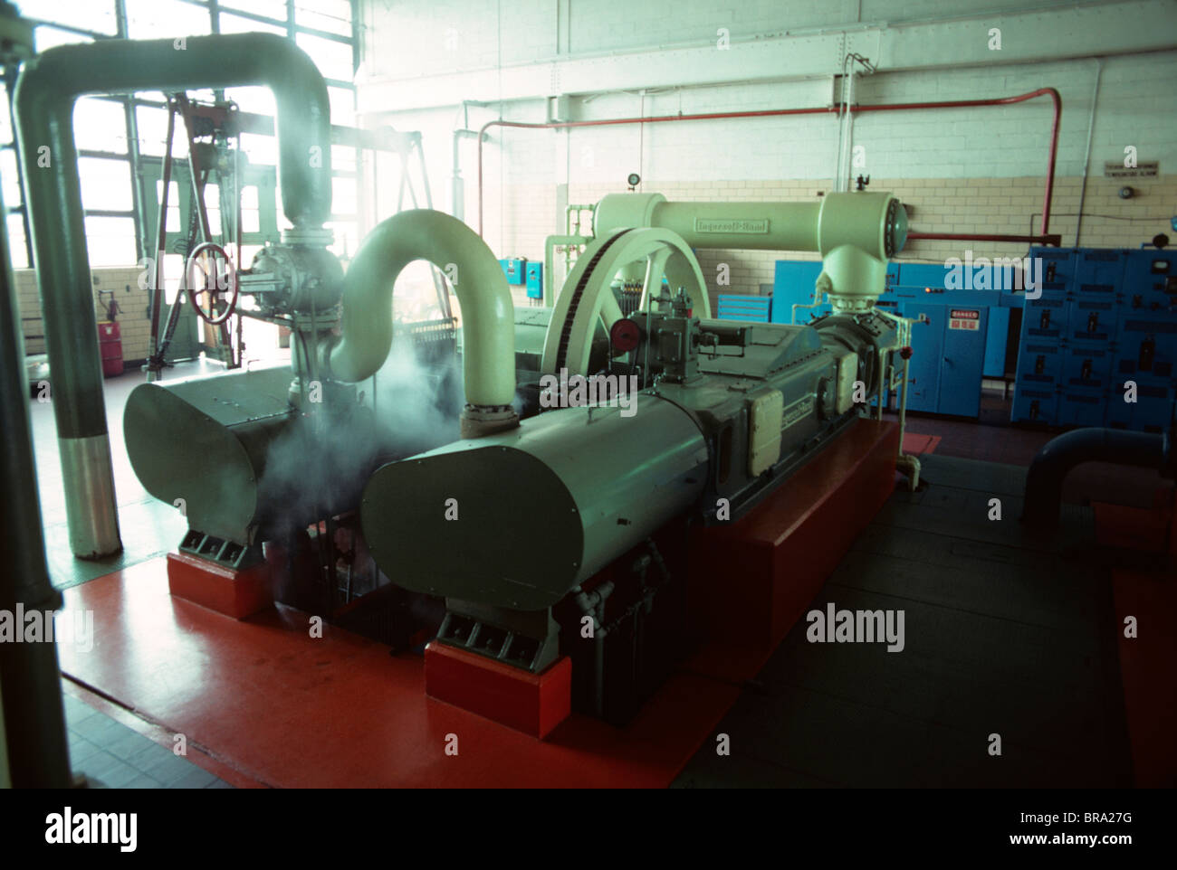 1970s INTERIOR FACTORY MACHINERY GENERATOR IN AUTOMOBILE PLANT - Stock Image