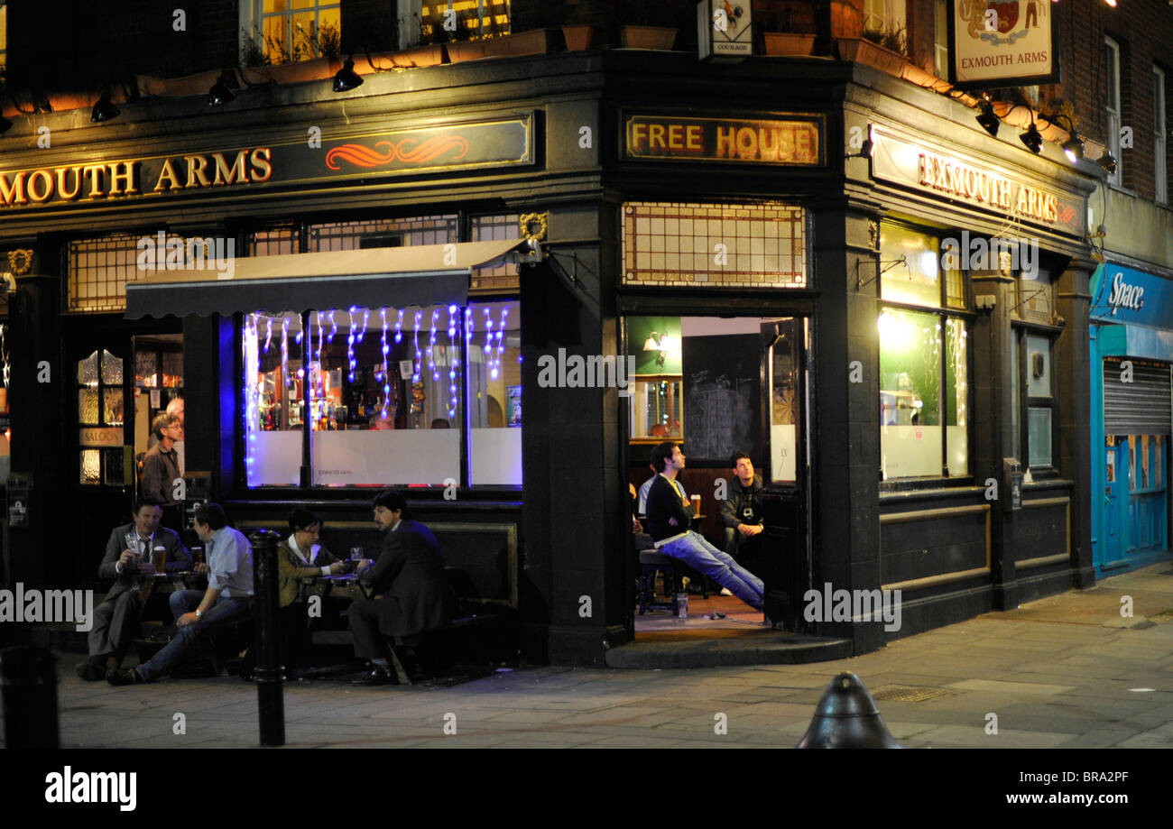 People watching football in pub Exmouth Market London - Stock Image