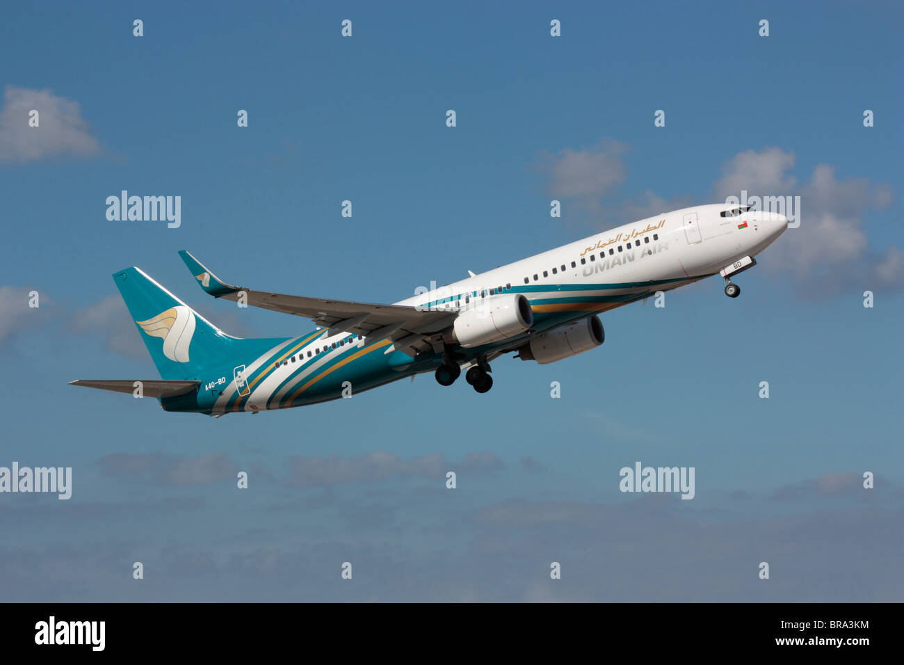 Oman Air Boeing 737-800 commercial jet airplane on takeoff - Stock Image