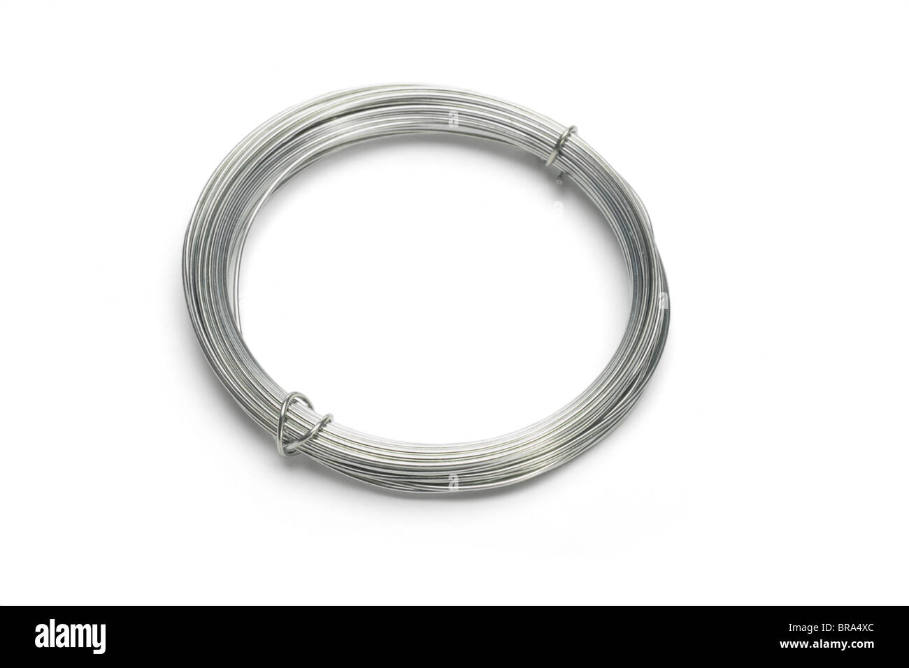Smalll roll of galvanized wires on white background Stock Photo