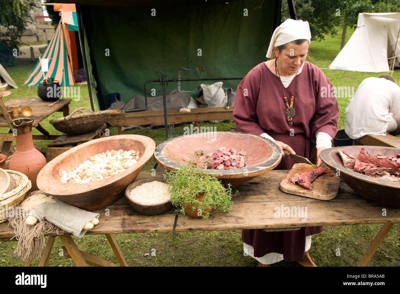 Woman cooking Historical re-enactment Saxon, Viking, Norman history, Woodbridge, Suffolk - Stock Image