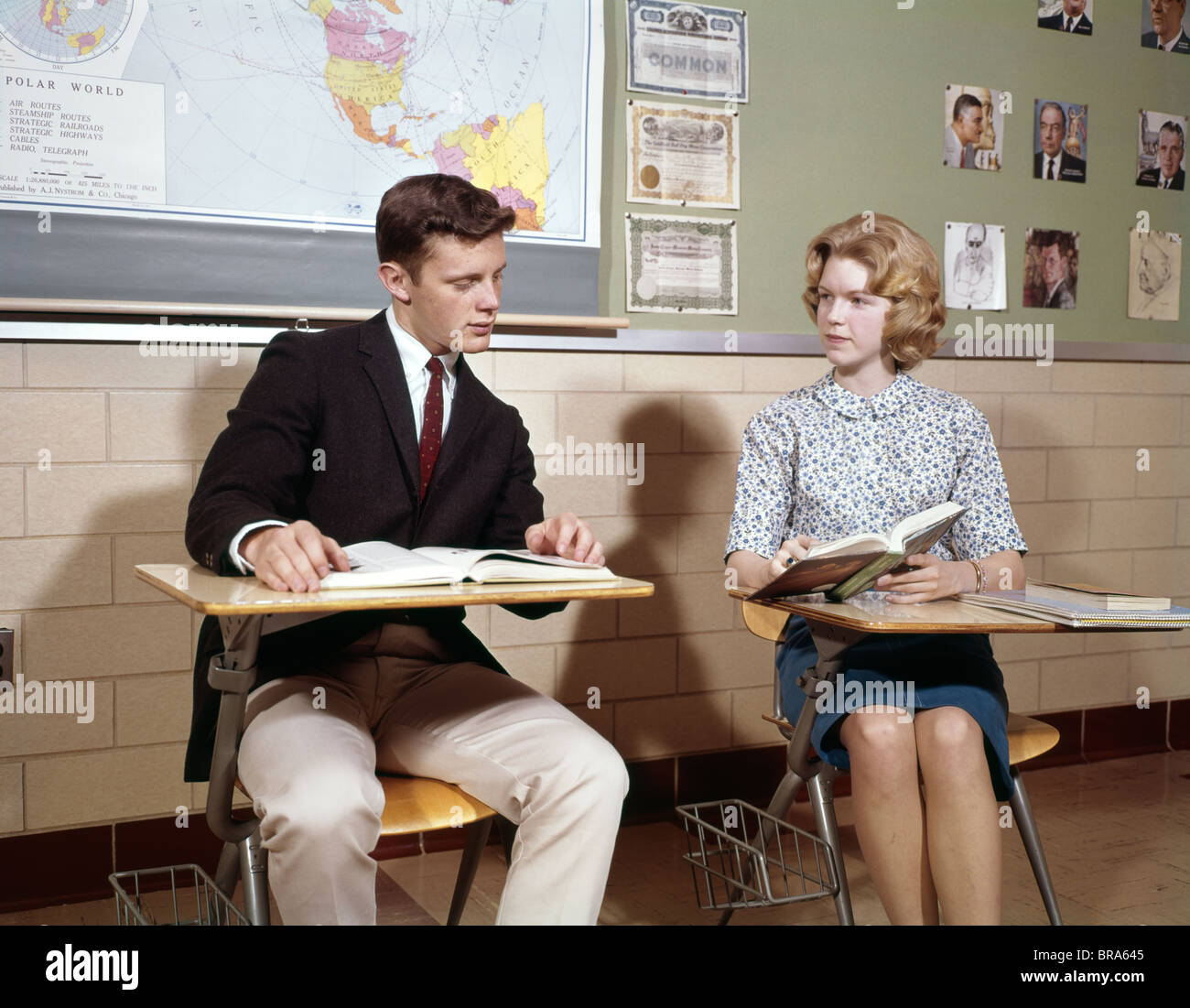 1960s Teenage Boy Girl Seated Classroom Desks Talking