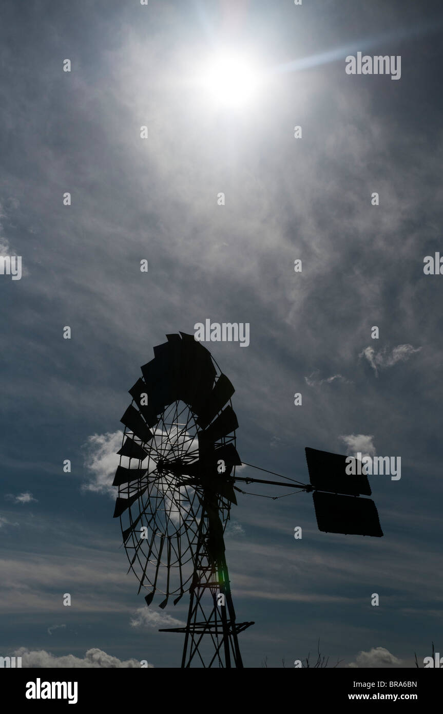 Agricultural water pumping windmill against the sky - Stock Image