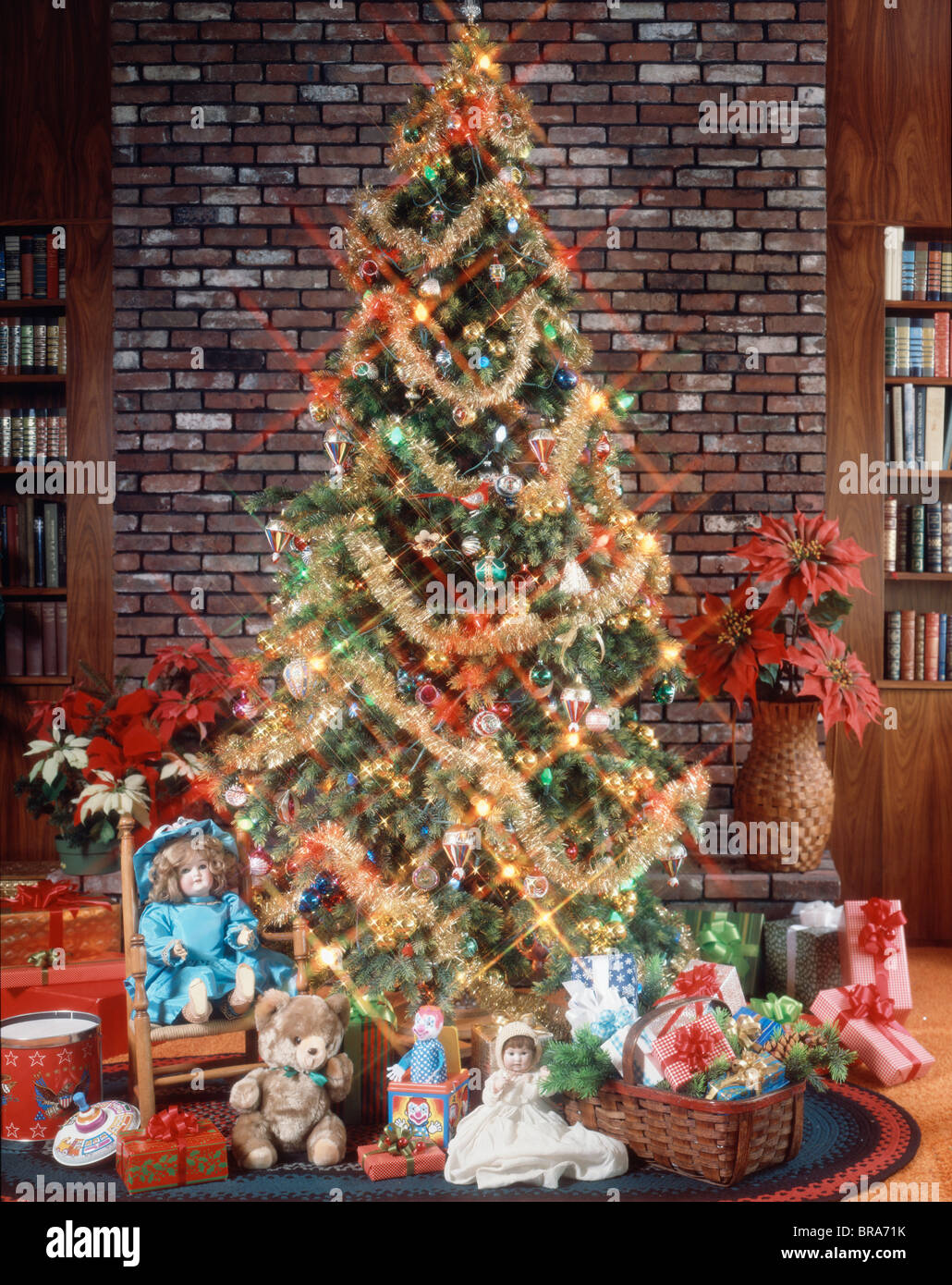 christmas tree with decorations garland lights toys and presents under tree - 1980s Christmas Decorations