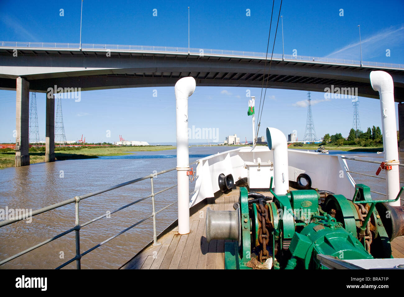 The MV Balmoral as it cruises under the A5 motorway Avon bridge at Avonmouth near Bristol and into the river Severn - Stock Image