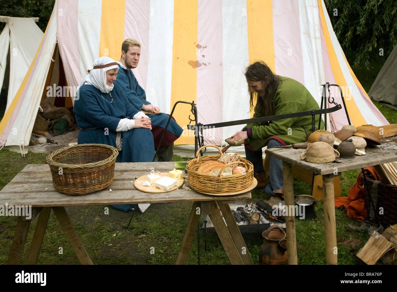 Family group eating Historical re-enactment Saxon, Viking, Norman history, Woodbridge, Suffolk - Stock Image