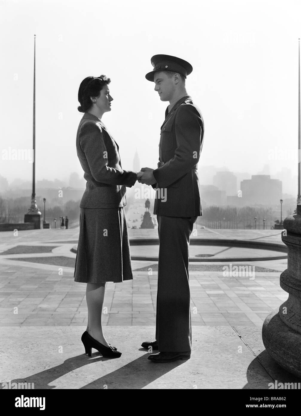 1940s COUPLE MAN WOMAN HOLDING HANDS STEPS PHILADELPHIA ART MUSEUM - Stock Image