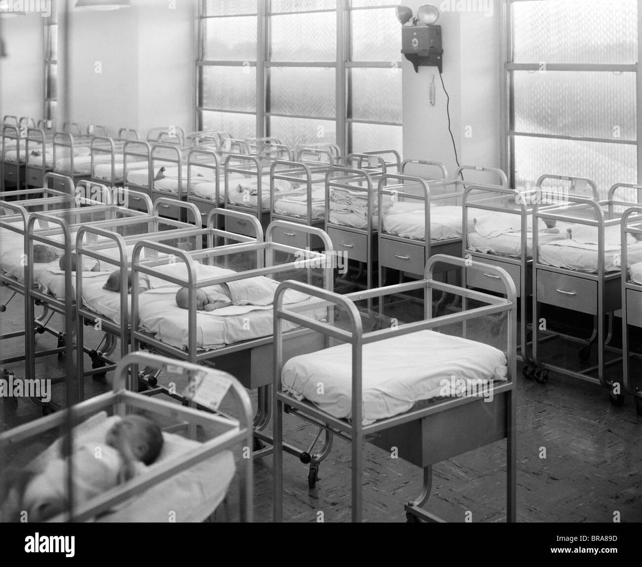 1950s 1960s Babies In Hospital Nursery Cribs Stock Photo