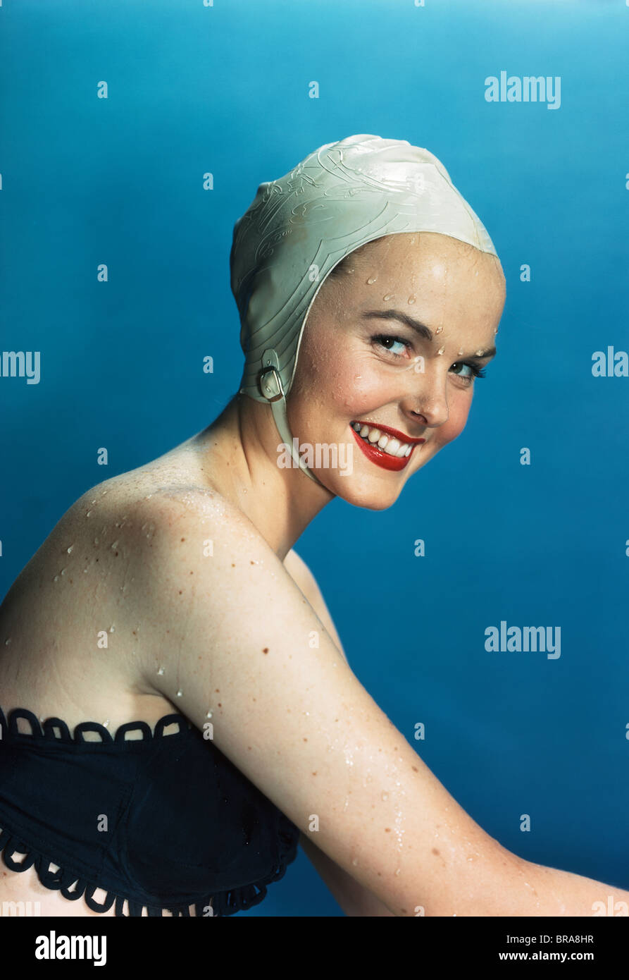 de389735170b6 1950s SMILING WET WOMAN WEARING WHITE SWIM CAP AND BLACK BATHING SUIT -  Stock Image