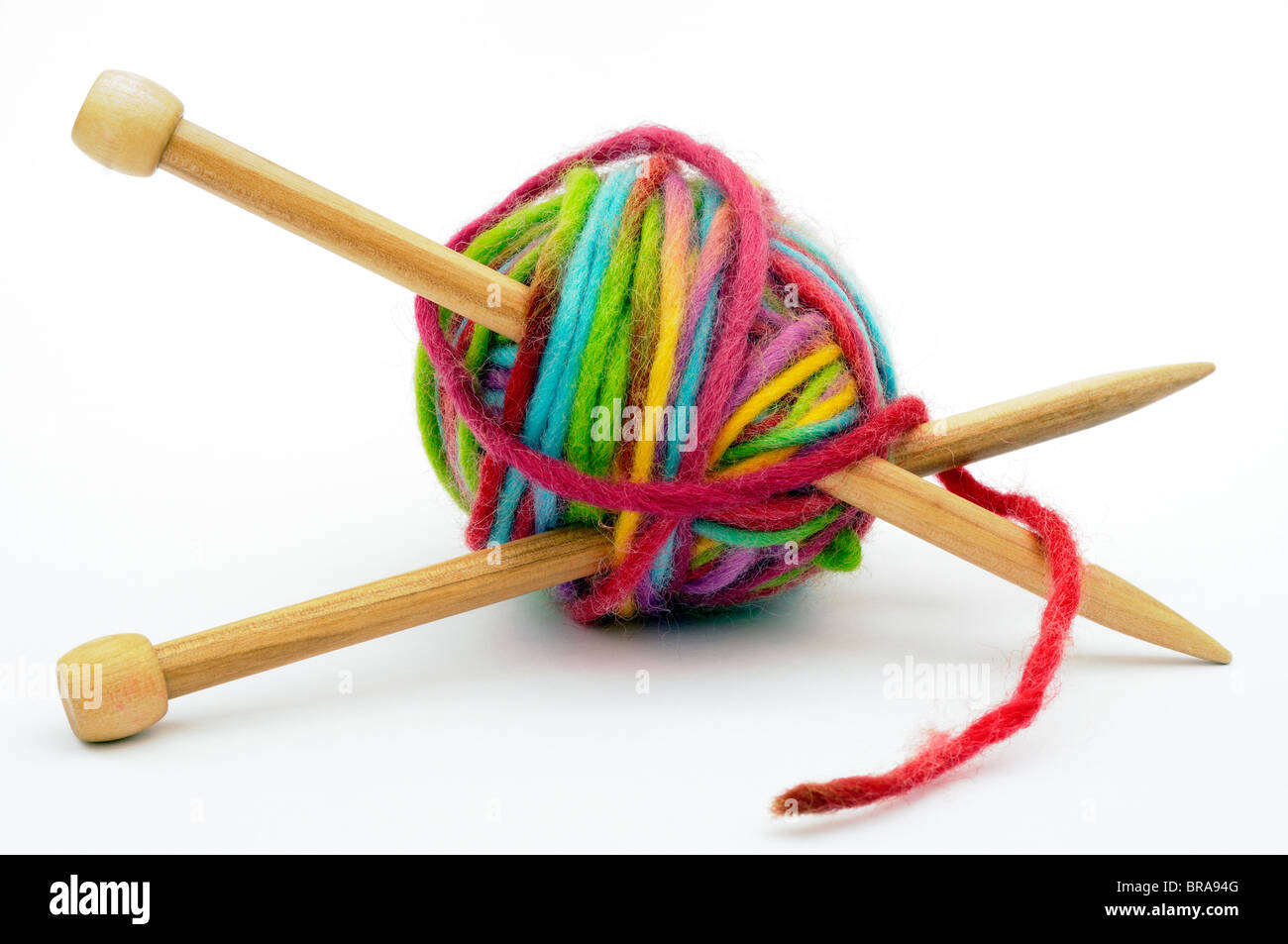 Multi colour ball of wool on white background Stock Photo