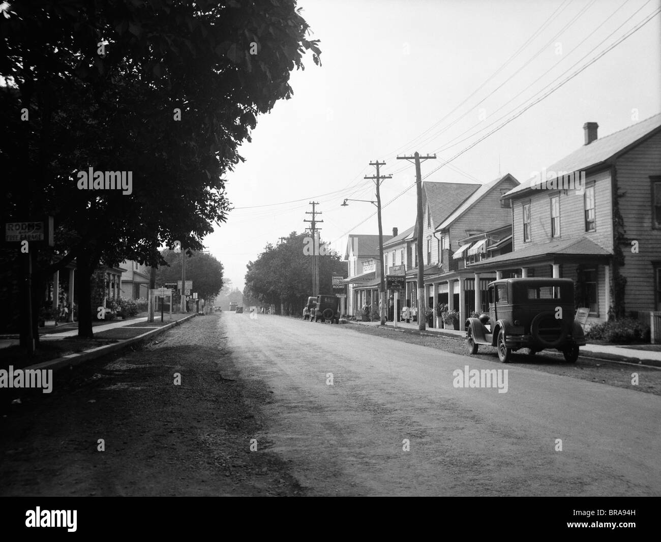 1930s JENNERSTOWN PENNSYLVANIA LOOKING DOWN THE MAIN STREET OF THIS SMALL TOWN - Stock Image