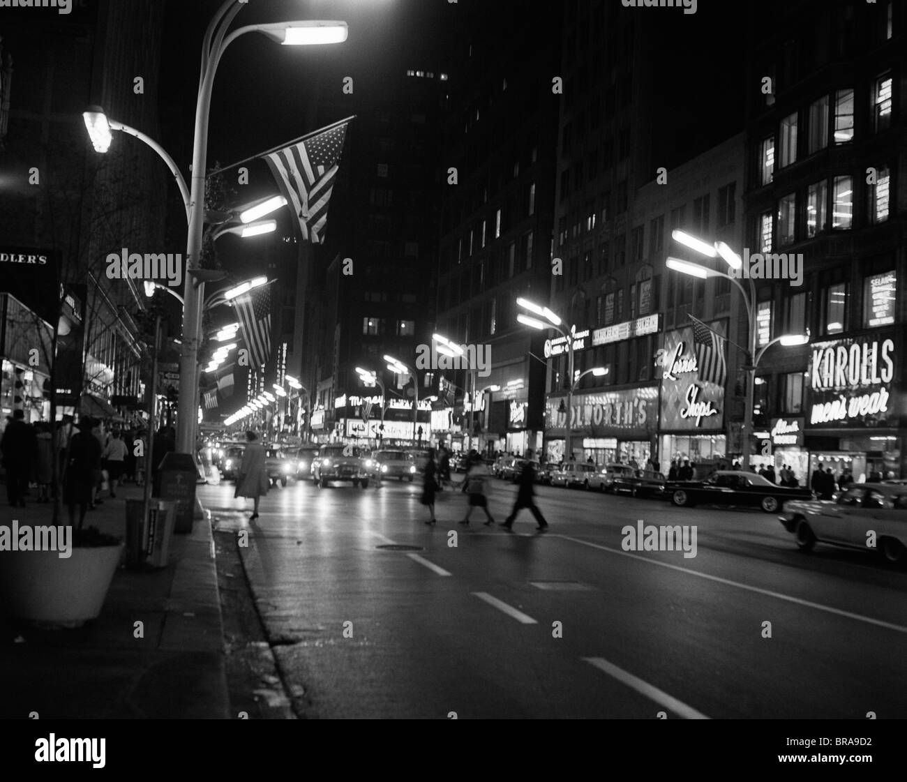 1960s 1963 NIGHT SCENE OF BUSY TRAFFIC ON STATE STREET CHICAGO ILLINOIS - Stock Image