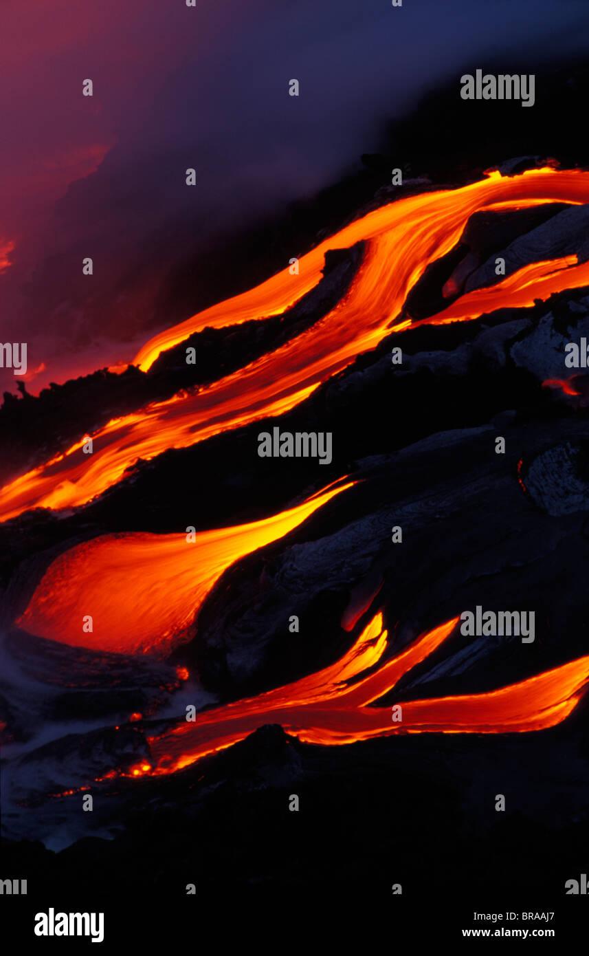 Lava flow from Kilauea Volcano entering Pacific Ocean Hawaii Volcanoes NP world's most active volcano - Stock Image
