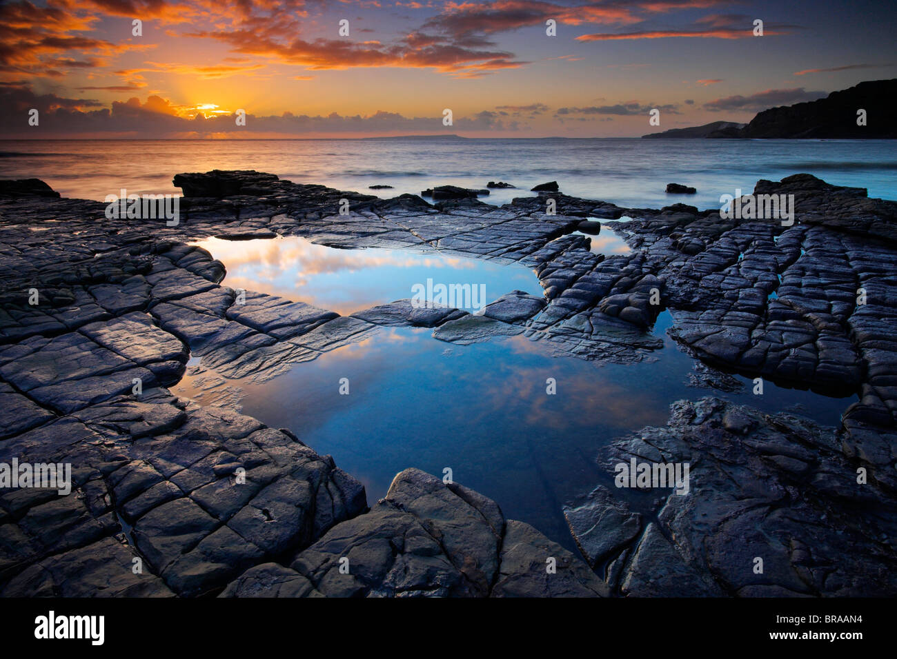 Rockpools on Broad Bench, looking towards Gad Cliff and the Isle of Portland, Dorset, England - Stock Image