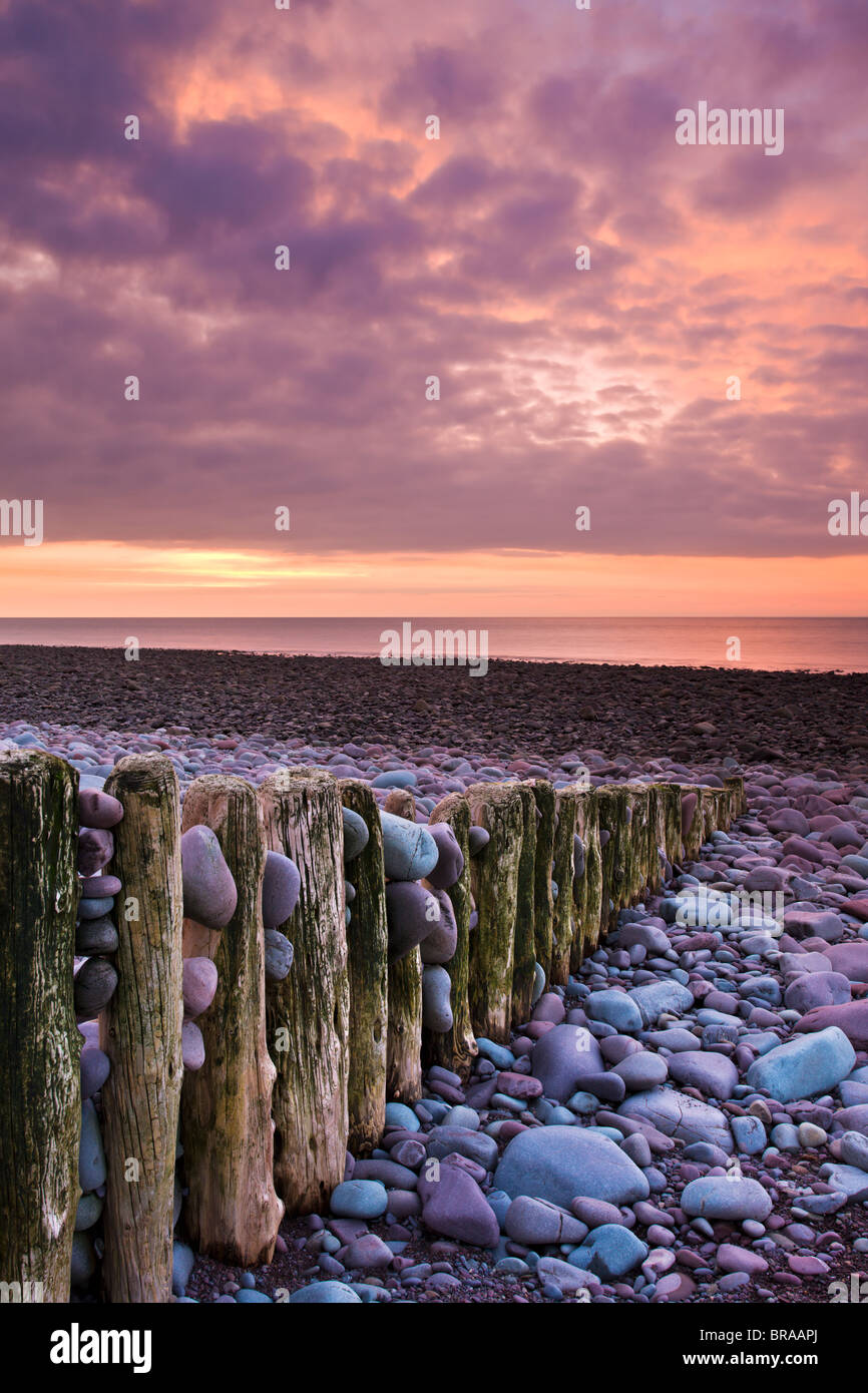 Weathered groyne and pebbles at Bossington Beach, Exmoor NP, Somerset, UK - Stock Image
