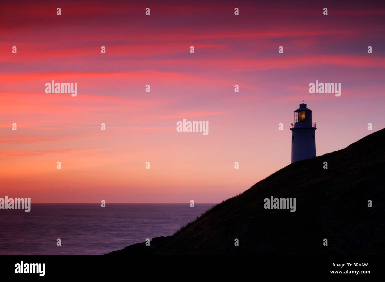 Trevose lighthouse at sunset, near Padstow, Cornwall, UK. July 2008. - Stock Image