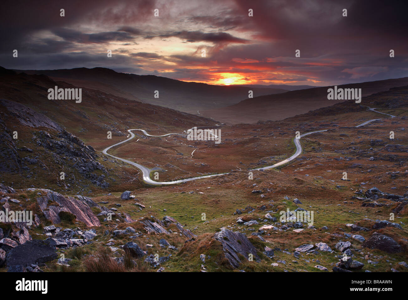 The road over the Healy Pass at dawn, Caha Mountains, Beara Peninsula, Co Cork, Ireland, October 2008 - Stock Image