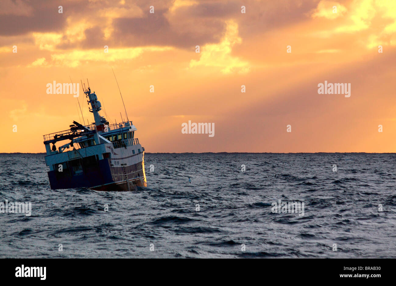 Trawler at sunset on the North Sea, September 2009.  Property released. - Stock Image