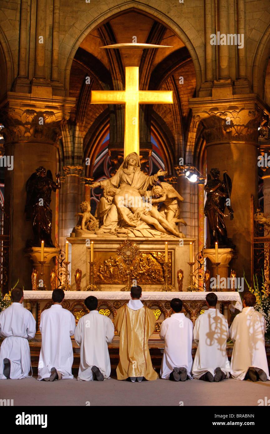 Eucharist adoration in Notre Dame de Paris cathedral, Paris, France, Europe - Stock Image
