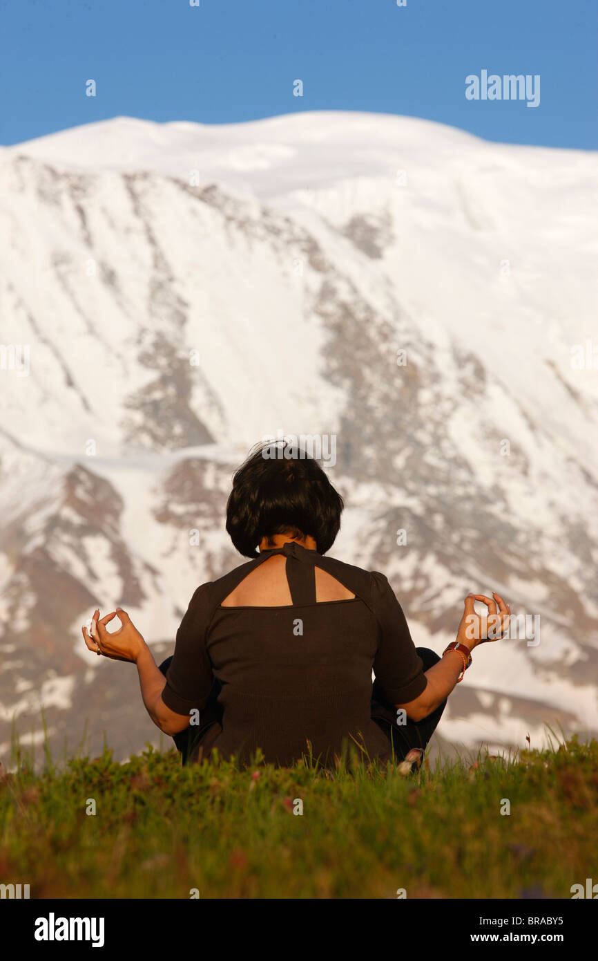 Meditation in front of Mont Blanc, Saint-Gervais, Haute Savoie, France, Europe - Stock Image