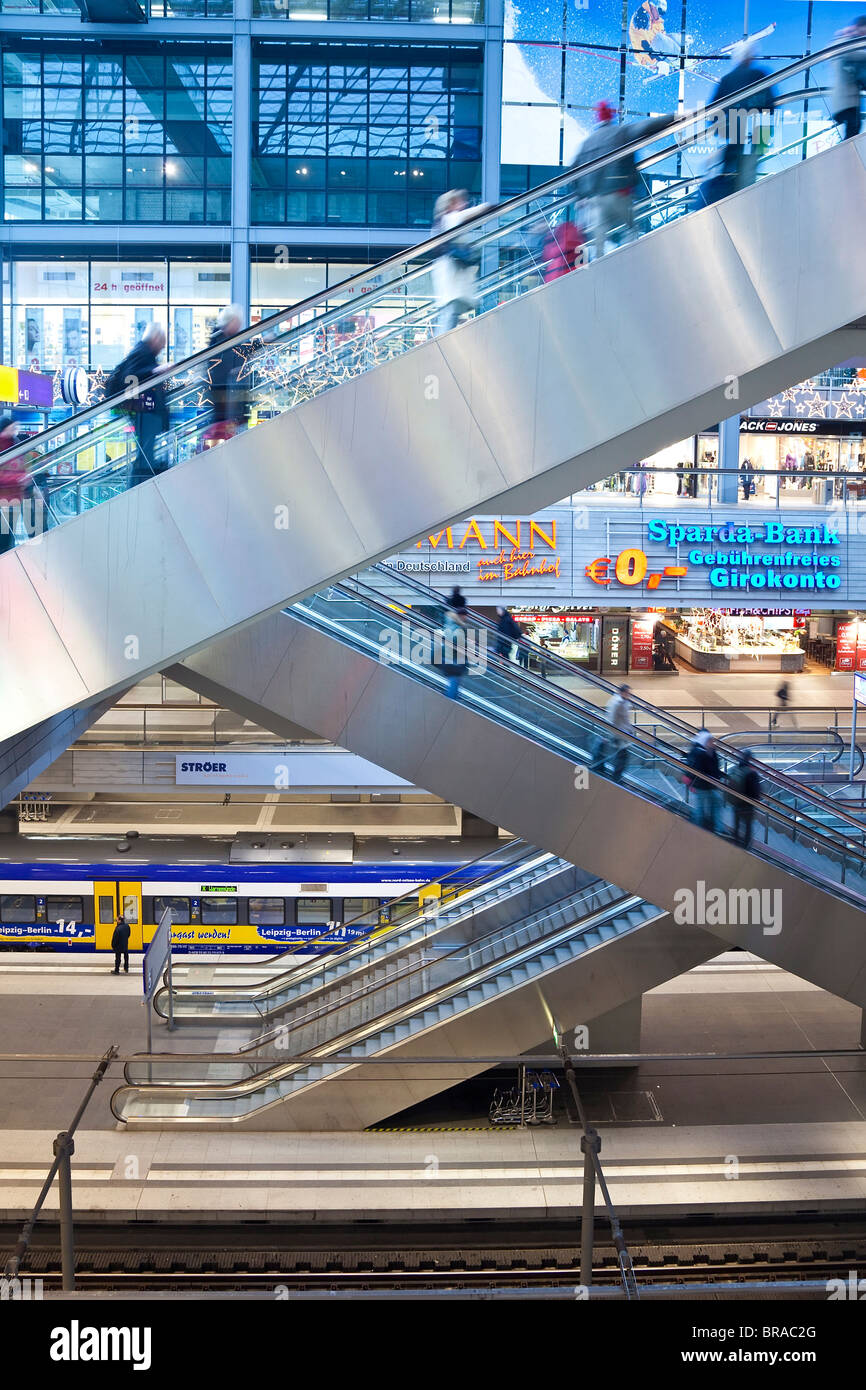 People moving up escalator at new modern main railway station, Berlin, Germany, Europe - Stock Image