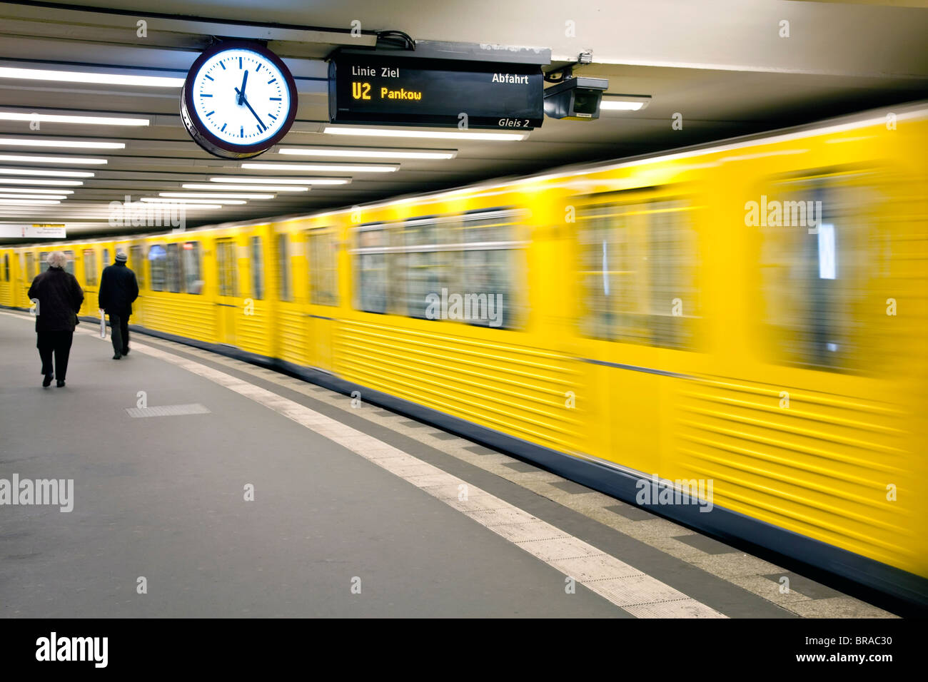 Moving train pulling into modern subway station, Berlin, Germany, Europe - Stock Image