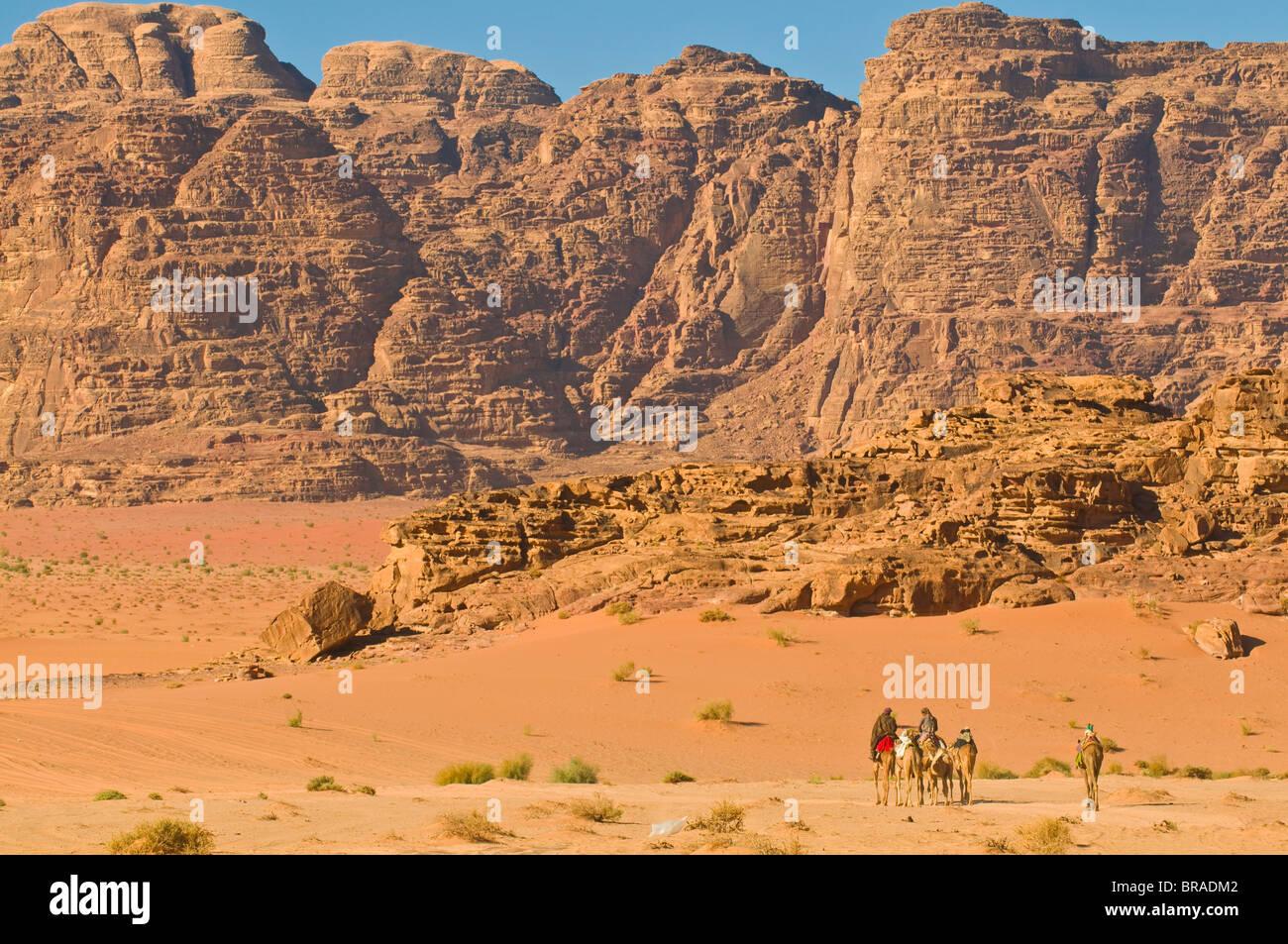Camel caravan in the stunning desert scenery of Wadi Rum, Jordan, Middle East Stock Photo